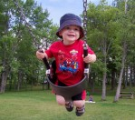 OF COURSE he was on the swings.  It's his favorite playground activity!