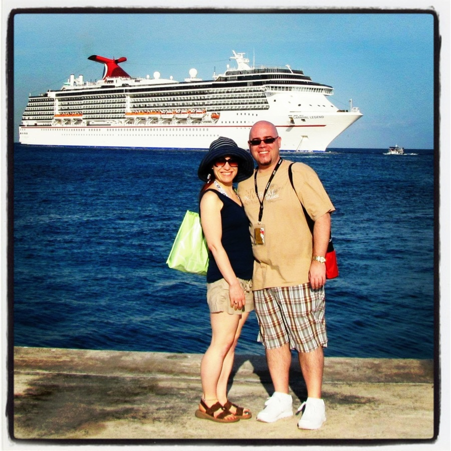 03-20-12 -- Sunshine and I (in our post-engagement afterglow) posing in front of the Carnival Legend on the  docks in Grand Cayman.
