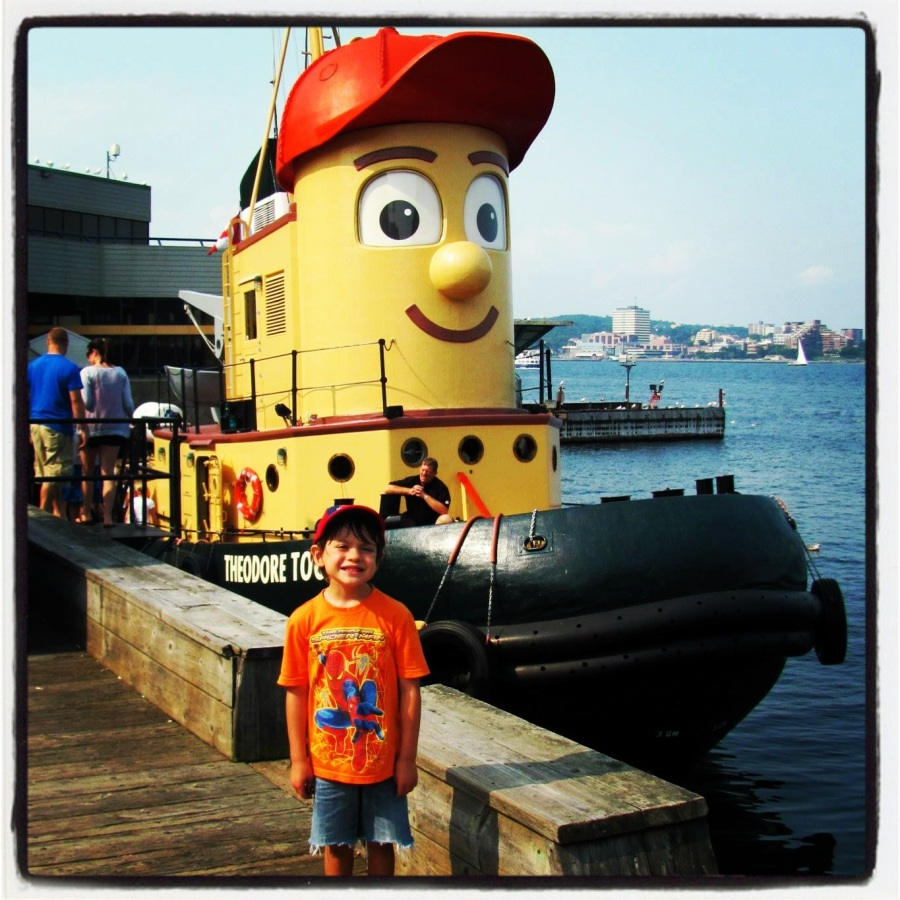 08-18-12 -- Ankle Biter posing in front of Theodore Tugboat.