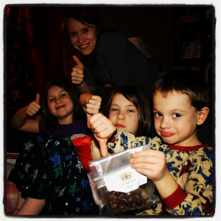 12-23-12 -- This was the collective reaction to chocolate-dipped bacon (seriously). Two thumbs up and two thumbs down. I wasn't really a fan, so I guess the thumbs down win.