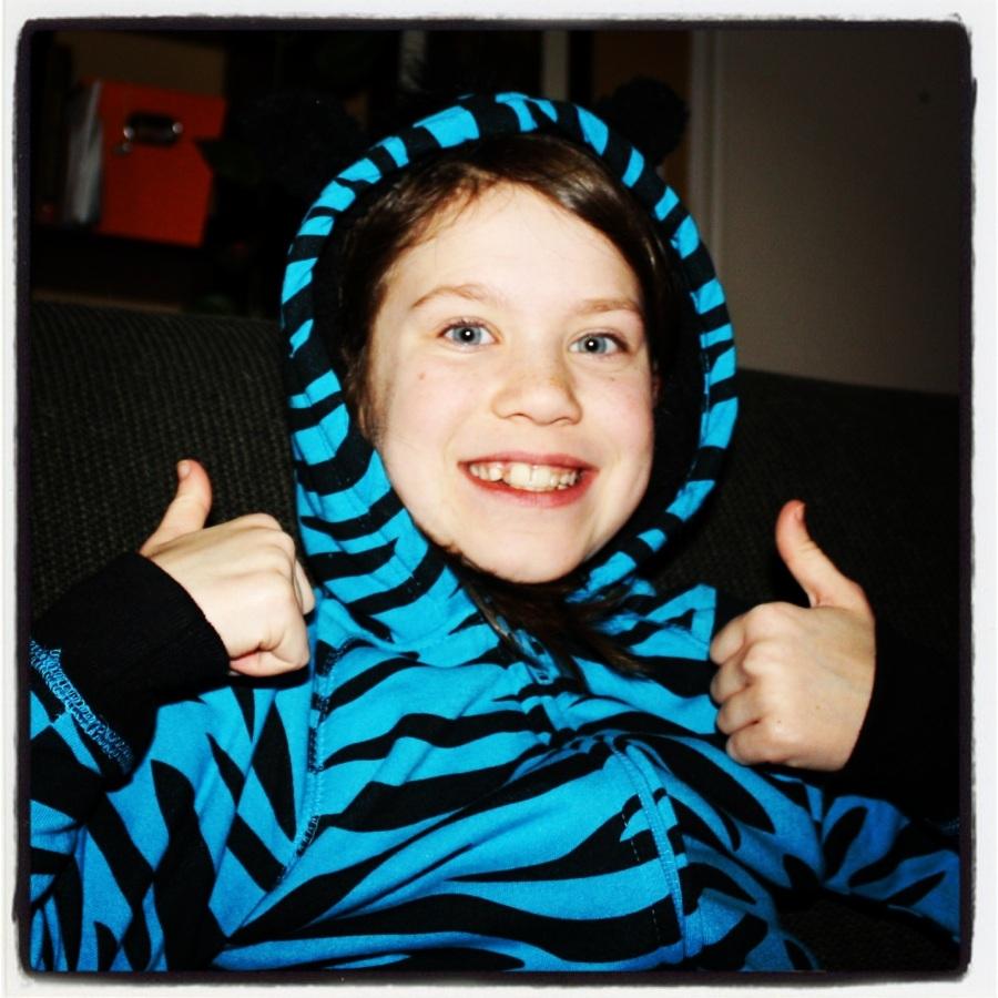 12-25-12 -- KIddo's favorite gift: the blue hoodie.