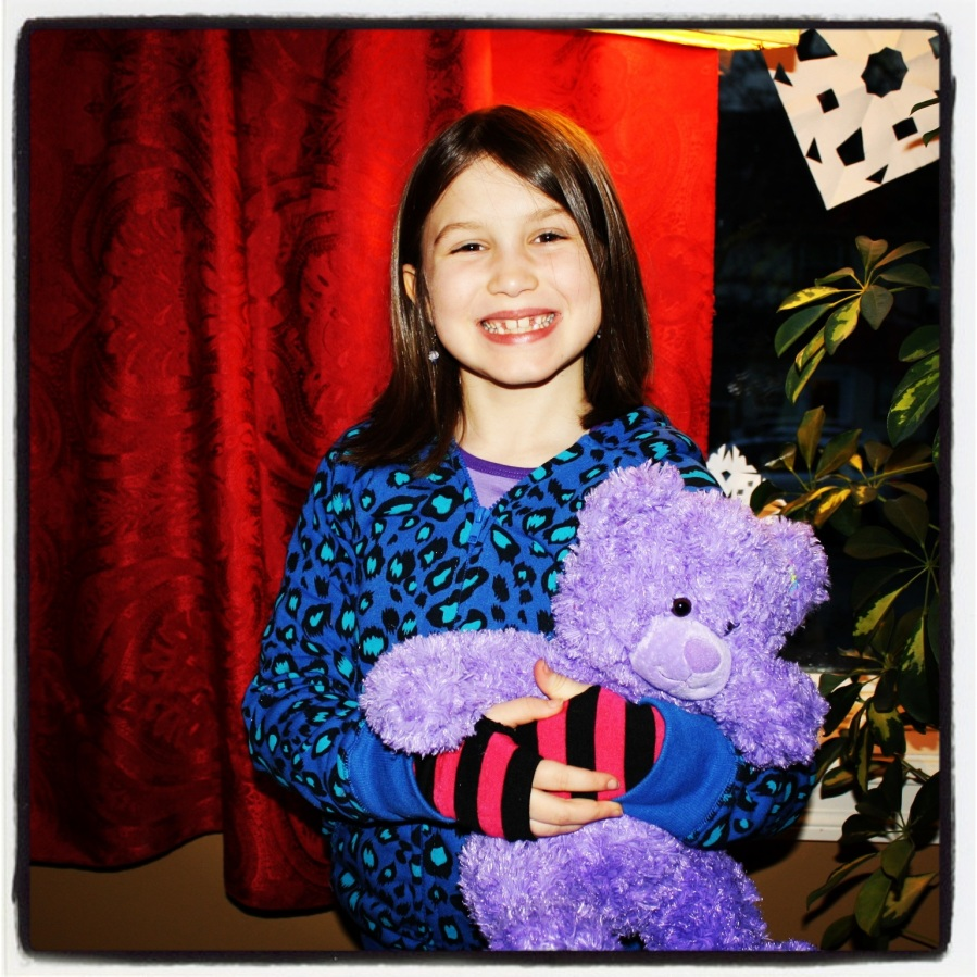 12-25-12 -- MoMo's favorite gift: the purple teddy bear.
