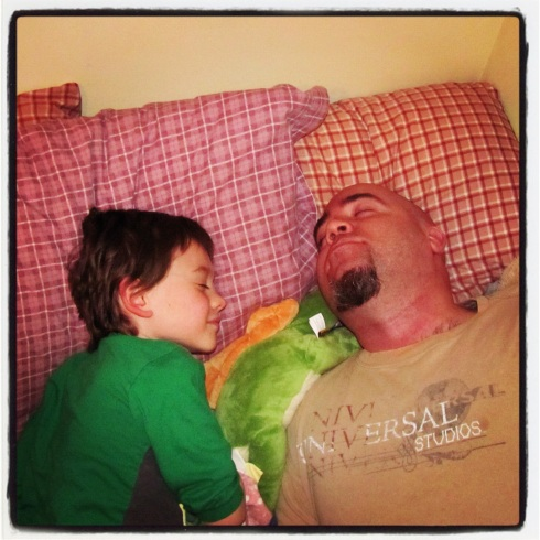 Awwww...father and son all tired out after a long day.