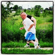 "This is my at my lightest weight of 212lbs, running ""The Race"" last summer."