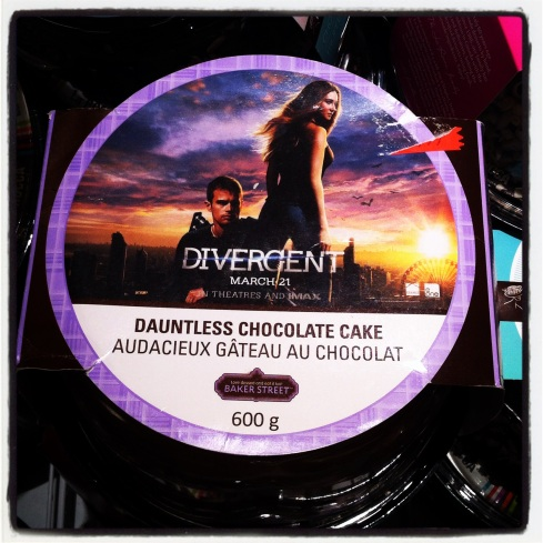 "So apparently ""dauntless"" is 1 of 5 factions in the world of Divergent, the faction dedicated to courage & bravery. So a few questions: 1. Why do I want ""brave chocolate cake""? 2. This cake is promoting a movie to be released in March...just how damn old IS this cake, anyway?? 3. You can see in the upper right hand corner that there WAS a discount sticker on this cake...but no more. WHY???"