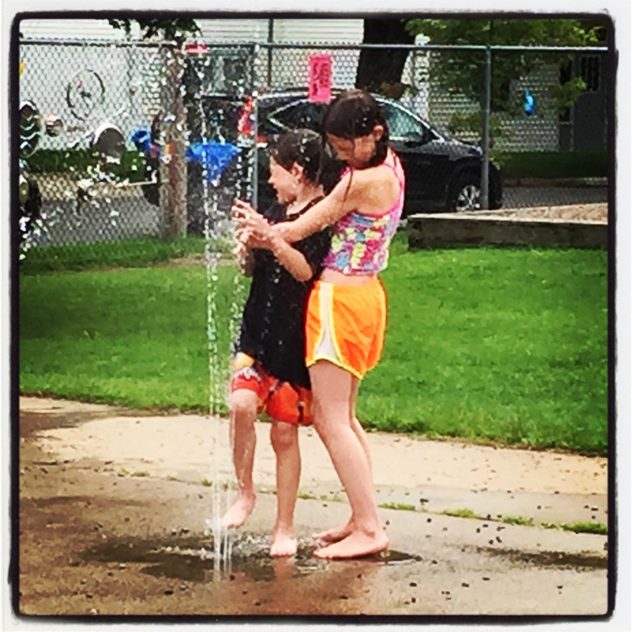 During the afternoon, it was scorching hot so we walked down to the local park. There was a very small water feature that spit out water randomly, just to cool the kids off. This shot happened just as the water surprised both Ankle Biter and Kiddo. I got lucky.